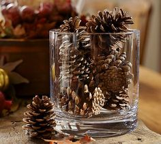 Last, a glass jar with pine cones or a candle and scatter pine cones on the runner.  I have mini pine cones galore in my back yard.