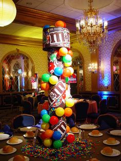 M & M themed centerpiece----A M party once a year, I know I'll treat myself for my birthday and have a M birthday party.