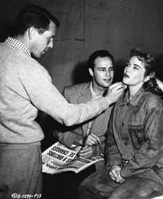 Marlon Brando watches sister Jocelyn being made up for her role in China Venture