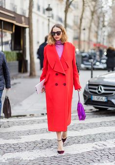 Candela Novembre wearing a red coat outside Balmain on March 2 2017 in Paris France