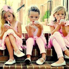 Adorable girls putting on lip gloss!