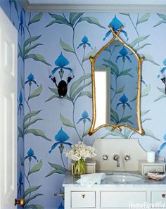 """The powder room was plain and forgettable until designer Kristen Panitch gave it personality with Cole & Son's Orchid, """"the wackiest of all wallpapers in the house."""" Gilt mirror from Hollyhock.   - HouseBeautiful.com"""