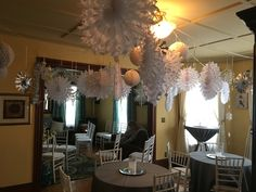 Winter wonderland baby shower theme. Dozens of different size snowflakes hung from iridescent beaded garland.