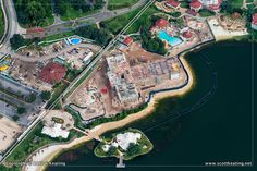 This shows the construction going on.  It shows the new Vacation Club building (middle of picture) right by the Wedding Pavilion.  It also shows the beach off the Summerhouse pretty much cut in half by a splash area next to the pool (upper right in the picture) - grand floridian construction update 2013   DizFanatic Aerial Photos of Walt Disney World Resort Hotels!