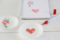 Cross-stitch ceramics - use ceramic markers... or you could do that thing with sharpies and baking them.