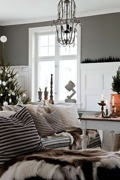 Explore this beautiful Scandinavian home decorated for Christmas with sophisticated white and grey. See more house tours at Decorator's Notebook.