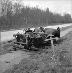 The grave of a British soldier who was killed during Operation Market Garden in 1944, lies alongside the wreckage of his jeep near Arnhem, 18 April 1945. Description from pinterest.com. I searched for this on bing.com/images