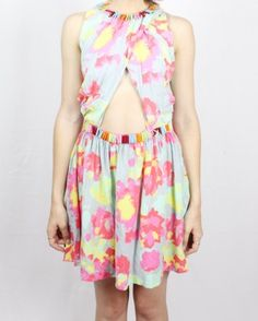 House of Wilde Wisteria Dress - The dress crosses over the front and back with a slightly gathered skirt and beautiful bright rectangular beads trimming the flat waistband and the neckline.