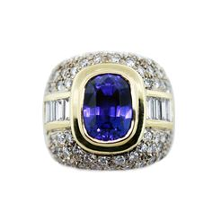 18K White/Yellow Gold Tanzanite and Diamond Ring - we adore the brigh violet tanzanite center stone. The ring is pretty hefty, so it's an attention grabber! We bought it with a matching tanzanite, diamond & gold necklace that's equally stunning.