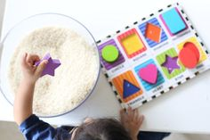 See how much fun this simple and effective toddler activity is. Place some shapes (or other puzzle pieces) into some rice and see what happens.