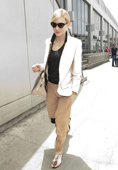 See All the Stars Acing Airport Dressing: Cate Blanchett arrived at LAX in a chic pairing: a white blazer, tan Chloé trousers, and beaded Roger Vivier sandals.