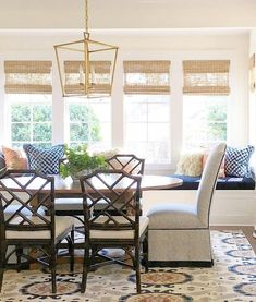 This pretty dining area proves that good classic design wins. I love white exteriors even more now.  Warm whites & m...