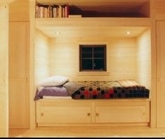 Simple design, built-in cupboards on either side, and that window. Need a rolling ladder to reach those books.