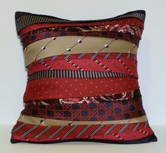 What a great idea!  Upcycled Vintage Necktie Pillow - Red/White/Blue. via Etsy.