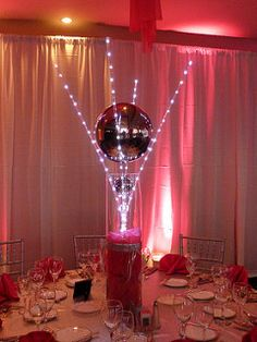 Custom LED light wand centerpiece with mirror ball for a Bat Mitzvah at Kernwood Country Club in Salem MA