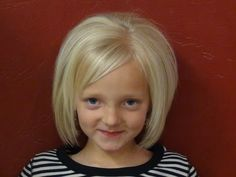 In this video, we had a little girl with long, straight, and thin hair.  The desired outcome was a short haircut with bangs that would make her hair look thicker.  It turned out adorable!  This cut will even look cute this summer when she gets out of the pool and her hair air-dries.   See our styling tutorial for this cut, Style Short Hair on Li...