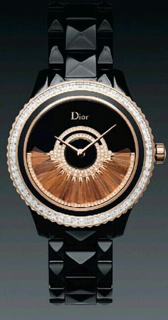 This watch has wow factor: Christian Dior black band watch with duo-tone blinged face. So wearable.