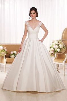 Style D1790 -  Elegant wedding dress idea - scalloped Lace illusion shoulder straps and back, a full Pearl Mikado skirt, and a slimming band of Pearl Mikado at the waist. Explore more dresses by @essensedesigns on @weddingwire!