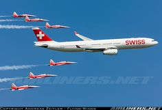 "Swiss International Airlines Airbus A330-343 being escorted by Northrop F-5E Tiger IIs of the Swiss Air Force ""Patrouille Swiss"" demonstration team"