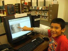 Boy in school library enjoys seeing naked woman on Internet computer