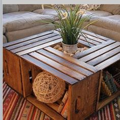 DIY wooden crate/box coffee table with a plant centre.