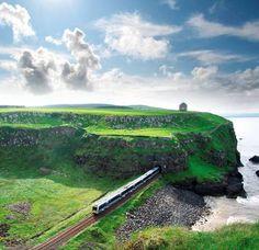 Top 10 Irish train journeys: The Derry to Coleraine railway, with Mussenden Temple. Photo: Tourism Northern Ireland