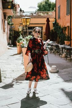 Pleated midi floral dress, gucci ace sneakers, straw bag, sunglasses, andreea birsan, couturezilla, cute summer outfit 2017, h&m midi floral dress, black and red dress, how to wear a midi dresss with sneakers, gucci ace heart embroidered sneakers, dress and gucci sneakers, heart embroidered white sneakers, where to find the best sneakers, woven bag, raffia bag, basket bag, straw bag, mini bag for summer, round ray ban lookalike sunglasses, wide belt, what to wear on a summer eurotrip,
