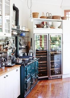 "Kitchen: Like the shelving with baskets above commercial refrigerator. Makes the ""commercial"" more homey. Nice idea!"