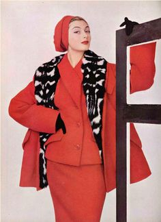 1954 Marie-Hélène in red wool suit worn under 34 coat with shawl collar lined in civet, by Jean Patou