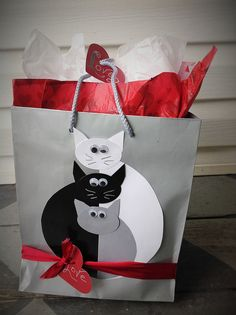 3 Cats Valentine Gift Bag - Cats are made from 3 half circles and 3 ovals.  Then add ears, whiskers and eyes. http://www.pinterest.com/bethob/wrap-it-up-with-a-little-whimsy/