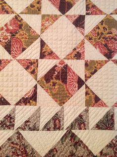 """Antique Chintz Quilt Signed 1852   eBay seller donebyme; 87"""" x 82"""", 3 different chintzes, signed by Anna M. Straeffer September 1, 1852. Outer 3.5"""" border in green and red floral on almost metallic gold & cream background, quilting stitches vary, perhaps, done by several people, about 8 stitches per inch"""