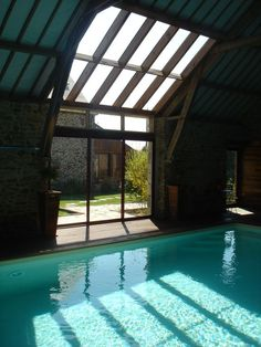 Rental holiday cottage the viscount-sur-rance swimming pool heated all year roun Indoor Swimming Pools, Swimming Pool Designs, Garage Door Styles, Sunroom Addition, Basement Pool, Barn Renovation, Deco, Future House, Indoor Outdoor