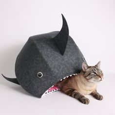 The great white shark cat bed is the Cat Ball® cat bed, and was created to celebrate Shark Week, and may perhaps be the most unique cat bed your cat could ever nap in! This funny pet bed makes a great photo prop - just see our Instagram feed!  We all know that your cat is practically useless, until it comes to entertainment. Only then does the domestic house cat shine! What better way to spend your time than to feed your lazy family pet to the fishies? It may not be Shark Week right now…