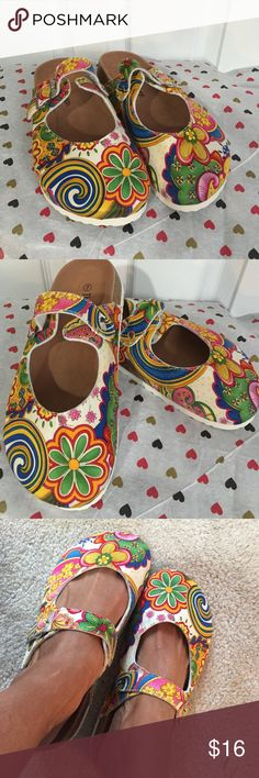 The Paragon Brand Mules Beautiful and Gorgeous Pattern. Used once for a couple hours thats all.. So shoe underneath is almost no wear! Paragon Shoes Mules & Clogs