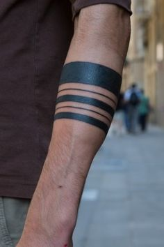 I love the forearm line tattoos.. I have been considering the idea for a memorial of ones lost and the thickness of the lines for importance in my life. But... might have to be white for my line of work.