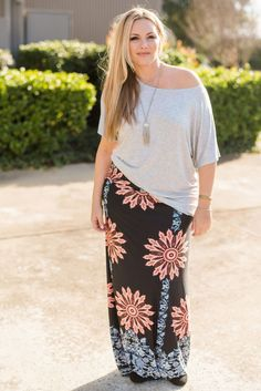 Maxi skirts in a printed beautiful knit are always a good idea. Our freshest In Bloom Maxi Skirt in Floral Black is our pick for Spring. Pair it with one of our must have necessities for a pulled toge