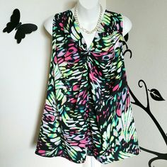 "Fairy Wing Print Sleeveless Top Colors in this beautiful sleeveless top include black, pink, green and white. Very comfortable, soft, and lightweight. It has a gathered front, and some stretch to it. Material is polyester.  Size is 3X Bust: Approximately 53"" Length: Approximately 28""  New with tags. Worthington  Tops"