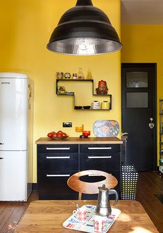 kitchen with yellow walls and black cupboards