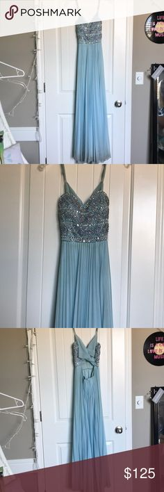 "PROM DRESS! beautiful blue prom dress! Worn twice, I'm short so it dragged on floor a bit and is a bit dirty on the bottom but it will come out in a dry clean! Fits small! I'm 5""2 but it's a bit longer then me! Make an offer 😊💙 love reign Dresses Prom"