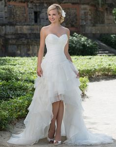 This organza high-low ball gown is a new approch to a Cinderella gown. It features a sweetheart neckline, side ruched basque waistline and classic lace up back.