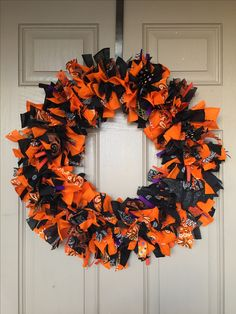 Made with one dollar bandanas from Walmart and ribbon tied to a wire frame ❤️ Halloween Wreath
