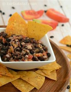 Healthy and yummy black beans belong to the high-fibre legume family. This dip can be stored in the fridge for up to a week! This is not really a creamy dip, but more like a salad to munch on with some chips.