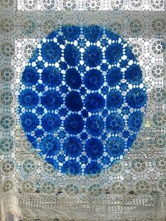 blue dot on lace curtain