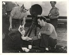 1943- U.S. submarine crew enjoys the luxury of fresh milk after returning from a long patrol voyage at sea.
