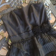 White House Black Market Ruffles Party Dress This Ruffles beauty still has its tags.  Rows of sheer pleated ruffles fill the skirt. Small pleats above and below the waistband.  Two fabric flowers finish this charmer.  Sheer edging at the top edges.  Removable straps. Back zipper size 2 White House Black Market Dresses