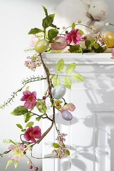 A bright mix of colorful faux spring blossoms and glittery eggs, this handcrafted garland from Pier 1 celebrates all the things you love about the season.