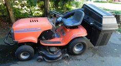 Husquvarna Lawn Tractor, Model YTH 180, With Mower Deck, and 3 tup Bagger attachment. Can be used with mulching cover as well. Includes instruction manual and key.