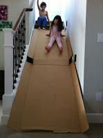 Cardboard stairwell slide. Your kids will never forget that you let them do something this fun!