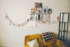sofa, garland, bunting, home, interior, living room, frames, gallery wall, mustard, art, map, vintage