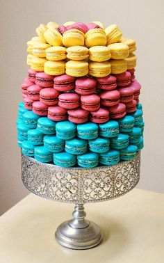 Yellow pink and turquoise blue macaron tower